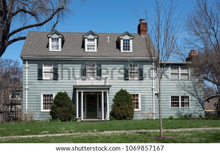 Deteriorated Blue Colonial House #1069857167