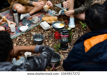 Friends camping in the forest together #1069857272