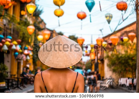 Girl with conical hat in Hoi An, Vietnam #1069866998