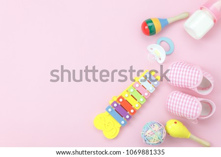Table top view kids toys for develop background concept.Flat lay object the colorful wooden ball & percussion musical instruments on modern paper pink at office desk.Design pastel tone with copy space #1069881335
