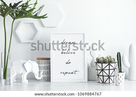 Creative desk with mock up white frame, cacti, elephant and notes. White and natural concept.