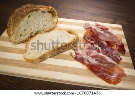 Bread and raw ham, a perfect match #1070071436