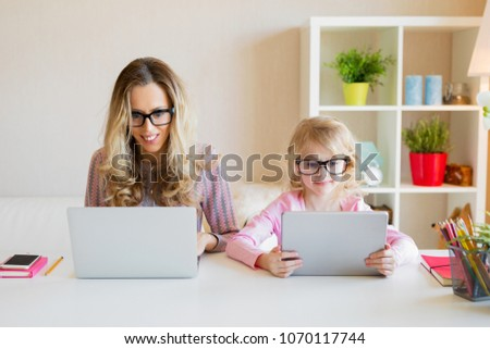 Mom and daughter using modern tech together #1070117744