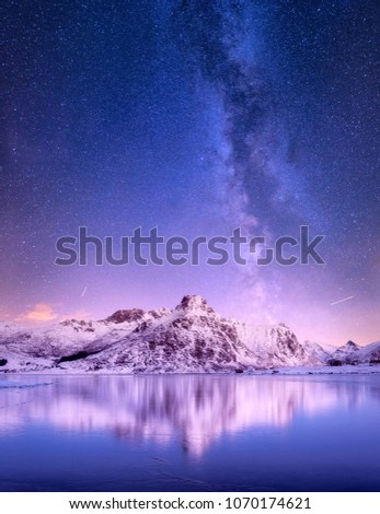 Mountain ridge and reflection in the lake. Natural landscape in the Norway #1070174621