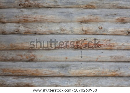 Background of wooden logs of heterogeneous structure. Natural material in construction in the form of tree trunks. #1070260958