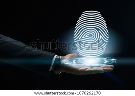 Abstract art of Hand of Business man Holding the virtual hologram future system.  Innovation Business Financial and Technology concept. #1070262170