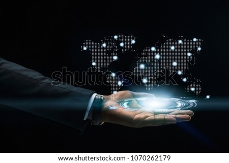 Abstract art of Hand of Business man Holding the virtual hologram future system.  Innovation Business Financial and Technology concept. #1070262179