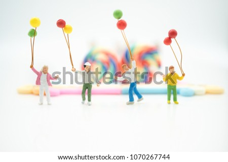Miniature people: Happy family holding balloons with copy space using as background international family day, happy, love concept. #1070267744