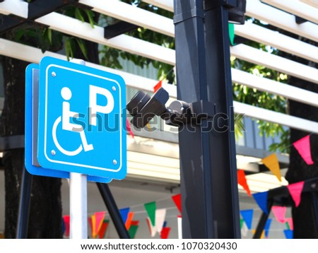 Close up blue handicapped parking sign at petrol station in Thailand.