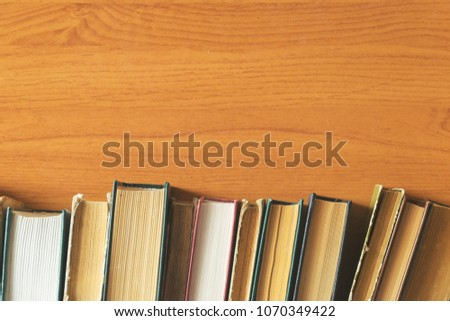 old books on wooden background #1070349422