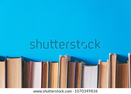 old books on blue background #1070349836