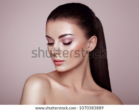 Beautiful Young Woman with Clean Fresh Skin. Perfect Makeup. Beauty Fashion. Eyelashes. Cosmetic Eyeshadow. Highlighting. Cosmetology, Beauty and Spa #1070383889