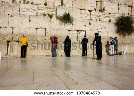 Jerusalem Israel April 16, 2018 Unknown people praying front the Western Wall at the old city of Jerusalem on afternoon #1070484578