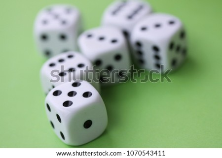 Dice game with dice isolated on green casino concept #1070543411