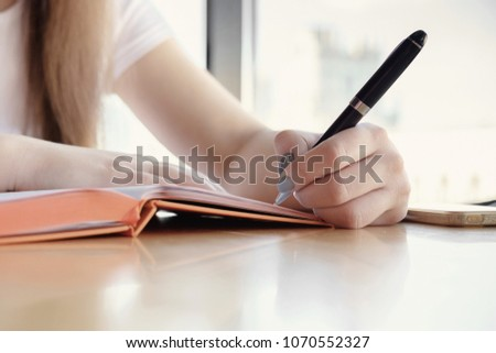 female hand pen for writing a diary #1070552327