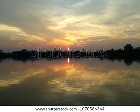 beautiful cloud pattern evening sky reflection in lake surface #1070586344