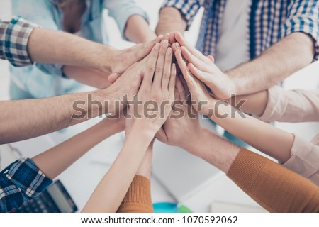 Cropped, close up portrait of business people's palms clasped together, giving high five to each other, harmony, agreement, achievement, joining, progress, connect, deal concept #1070592062