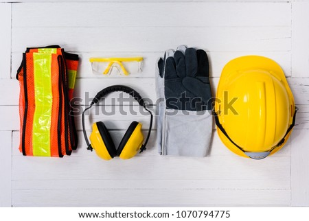 Standard construction safety equipment on white wooden background. top view, safety first concepts Royalty-Free Stock Photo #1070794775