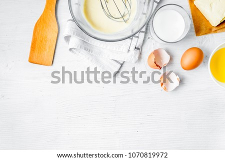 cooking pancake on white background top view ingredients for mak #1070819972