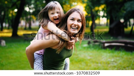 Little girl with special needs enjoy spending time with mother Royalty-Free Stock Photo #1070832509
