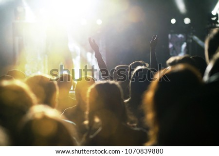 crowd with raised hands at concert - summer music festival #1070839880