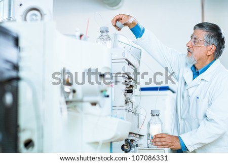 Senior male researcher carrying out scientific research in a lab (shallow DOF; color toned image) #107086331