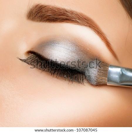 Makeup. Make-up. Eyeshadows. Eye shadow brush Royalty-Free Stock Photo #107087045