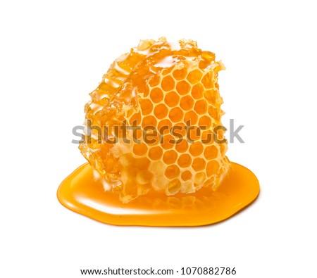 Honeycomb piece. Honey slice isolated on white background. Package design element Royalty-Free Stock Photo #1070882786