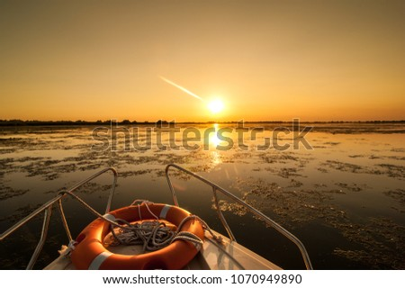 sunset in the Danube delta Romania.Beautiful blueish lights in water.Beautiful sunset landscape from the Danube Delta Biosphere Reserve in Romania