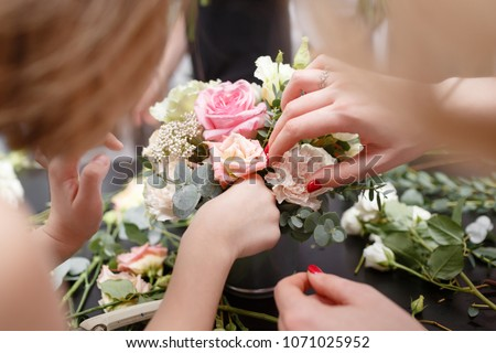 Master class on making bouquets for kids. Spring bouquet in metal ornamental flowerpot. Learning flower arranging, making beautiful bouquets with your own hands #1071025952
