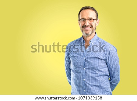 Handsome middle age man confident and happy with a big natural smile laughing, natural expression #1071039158
