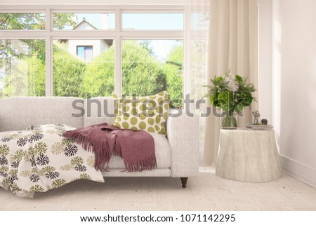 White room with sofa and green landscape in window. Scandinavian interior design. 3D illustration #1071142295
