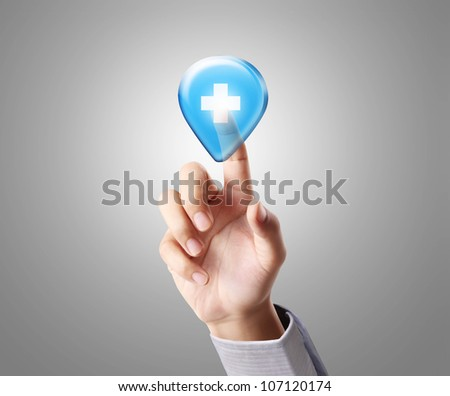 hand pressing a touchscreen button and Medical