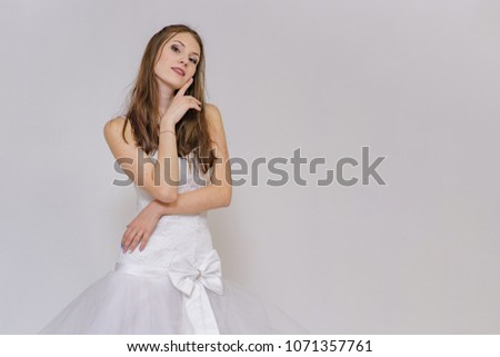 beautiful bride in white wedding dress in different poses on white backgrounds shows different emotions #1071357761