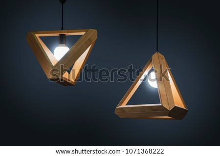 Beautiful wooden geometric modern ceiling lamp interior contemporary decoration isolated on a dark background. #1071368222