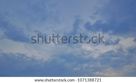 blue sky and white clouds on a clear blue sky in the day for use of backgrounds. #1071388721