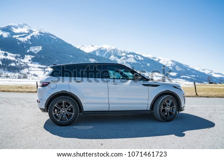 White Range Rover Evoque. Austria, Alps - March 25, 2018: Latest brand new white 2018 Range Rover Evoque. Beautiful car SUV in the nature deep in Alps. Range Rover bestselling model in the wild. #1071461723