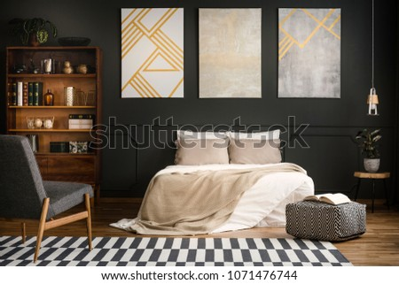 Modern wooden bedroom interior with white bed, carpet, bookcase and armchair #1071476744