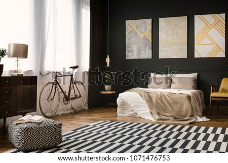 Vintage room interior with bed, bike, carpet on the floor and pouf #1071476753