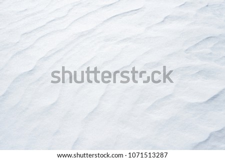 Fresh snow background texture. Winter background with snowflakes and snow mounds. Snow lumps #1071513287