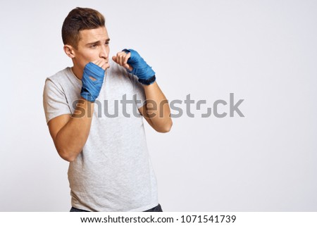 boxer with protection on hands, boxing                              #1071541739