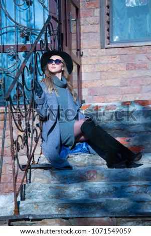 beautiful girl in a hat on a walk #1071549059