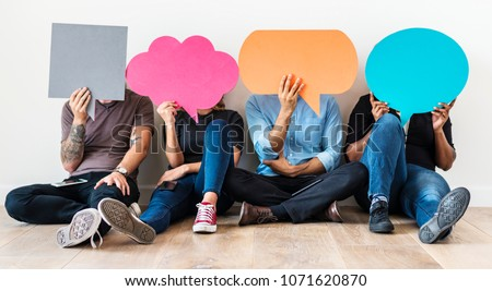 People carryng speech bubble icons Royalty-Free Stock Photo #1071620870