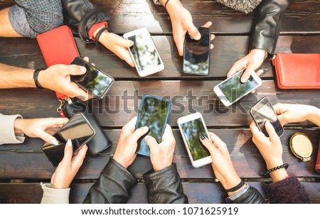 People group having addicted fun together using smartphones - Detail of hands sharing content on social network with mobile smart phones - Technology concept with millennials online with cellphones  #1071625919