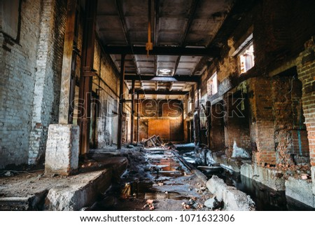 Abandoned ruined industrial factory building, corridor view with perspective, ruins and demolition concept, toned #1071632306