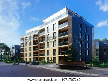 Pine tree at architectural complex of residential buildings. And outdoor facilities. #1071707360