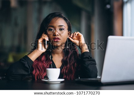 African american business woman with phone and laptop #1071770270