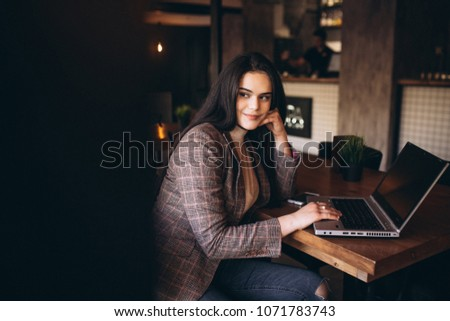 Business woman working on laptop in a cafe #1071783743