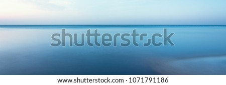 horizontal line of calm sea on the day light Royalty-Free Stock Photo #1071791186