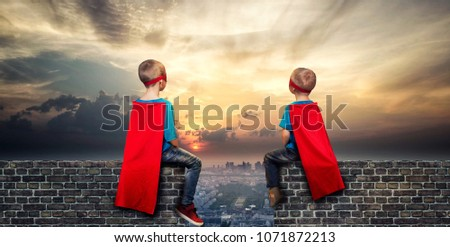 Children in superhero costumes guard the order in the city #1071872213